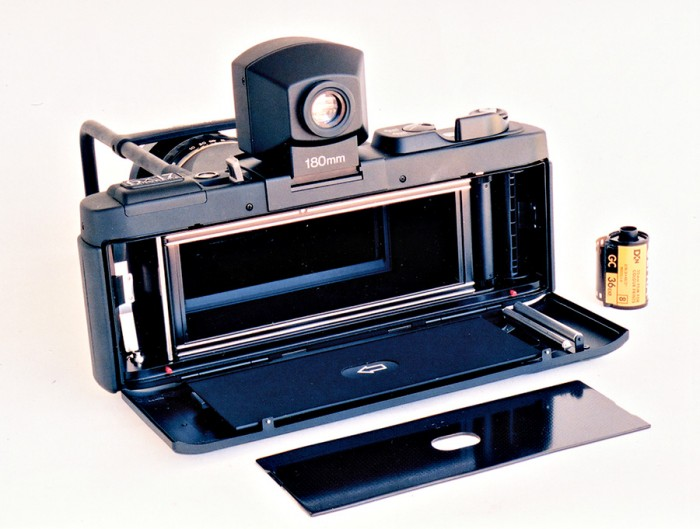 Fuji GX617 panoramic camera with a 35mm film canister to compare size