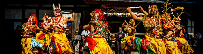 Costumed dancers in a Dance festival in Bumthang, Bhutan