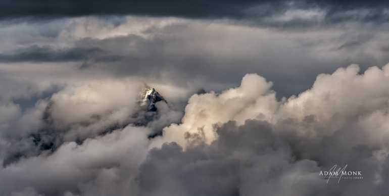 Bhutan Photo Tour, the Himalayas peaking out of the clouds