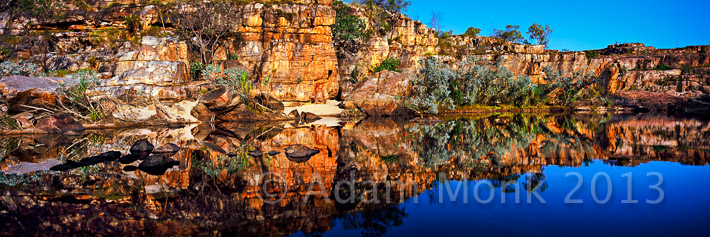 Panoramic photographic Image of Manning river at sunrise, around the corner from Manning Falls.  Mt Barnett Station off the Gibb River Road. Kimberley Region of Western Australia