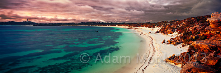 Panoramic photographic image of a stormy sunset at Salmon Bay Rottnest Island, off the coast of Fremantle Western Australia
